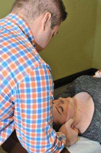 Merrillville Chiropractor John McDonald Adjusting Patient