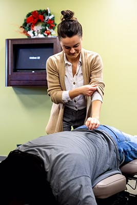 Chiropractor Crown Point IN Kristina Kauffman Beginning an Adjustment