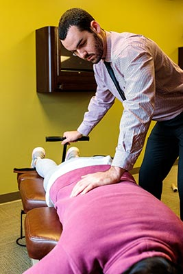 Chiropractor Crown Point IN Michael Kauffman with Patient