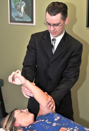 Merrillville Chiropractor Nicholas Kauffman Adjusting Patient