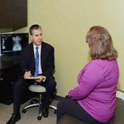 Chiropractor Merrillville IN Robert Kauffman with Patient
